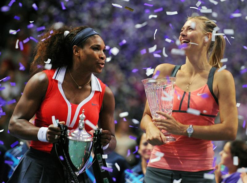 Serena Williams of the US, left, holds her trophy after her tennis victory against Maria Sharapova of Russia, right, after the final of the WTA Championships in Istanbul, Turkey, Sunday, Oct. 28, 2012. (AP Photo)