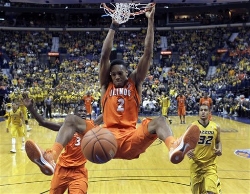 Illinois' Joseph Bertrand dunks the ball as teammate Brandon Paul and Missouri's Jabari Brown, right, watch during the second half of an NCAA college basketball game Saturday, Dec. 22, 2012, in St. Louis. Missouri won 82-73. (AP Photo/Jeff Roberson)