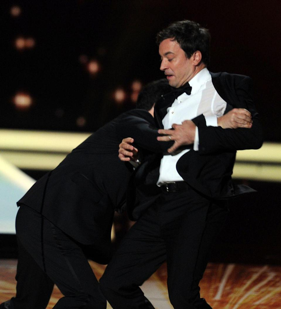 """<p>2011 was a good year for the Emmys. In another amusing bit, Jimmy Kimmel ended up tackling Jimmy Fallon on stage to steal the acceptance speech he wrote in case he ended up beating Jon Stewart. Kimmel got Fallon's speech and read it in full, which ended with Fallon saying, """"But most of all, I want to thank Jimmy Kimmel. Jimmy has been there for me since day one. He's the kindest and most supportive person in my life. He would never mock me or belittle me—especially in a large public venue such as this. I love you, Jimmy Kimmel."""" </p>"""