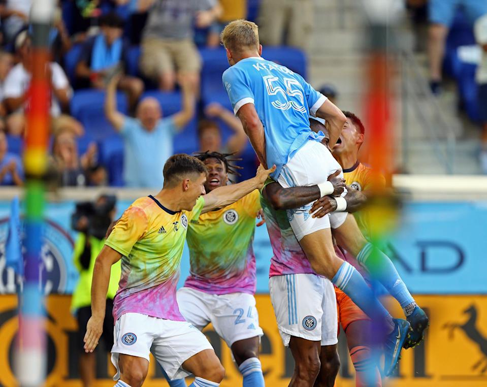 New York City FC midfielder Keaton Parks (55) leaps into the arms of teammates while celebrating his goal against D.C. United at Red Bull Arena.