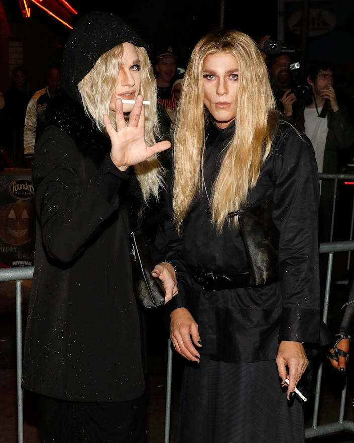 Neil Patrick Harris (left) and his husband, David Burtka, dressed up as the Olsen twins for Heidi Klum's Halloween party in New York. (Photo: Taylor Hill via Getty Images)