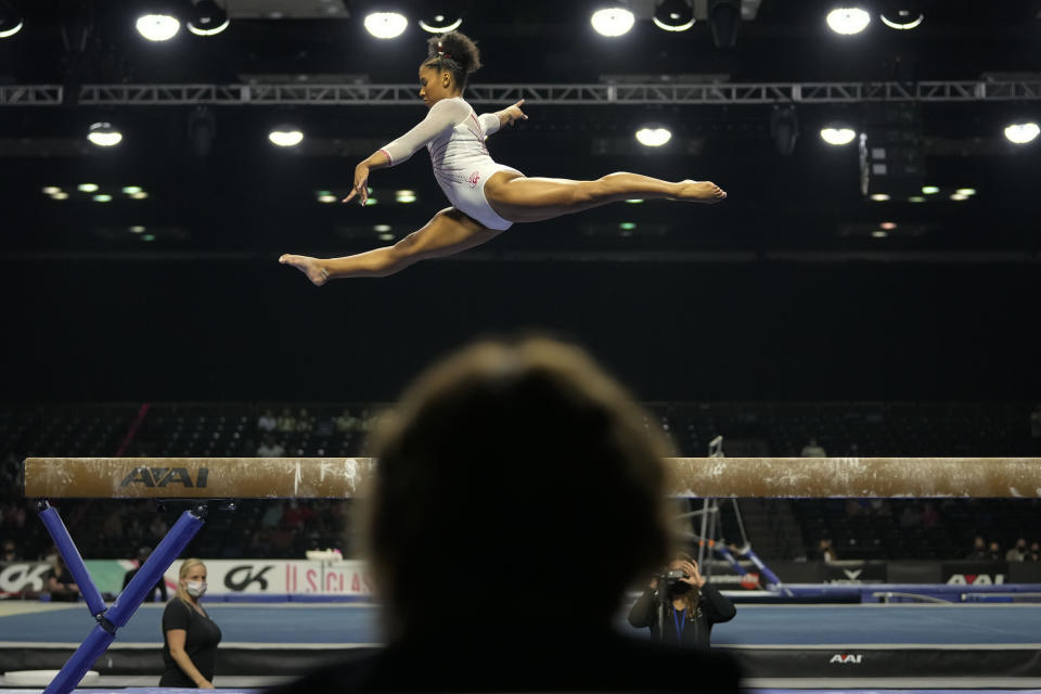 A judge watches as Jordan Chiles performs her balance-beam routine during the U.S. Classic gymnastics meet in Indianapolis, Saturday, May 22, 2021. (AP Photo/AJ Mast)