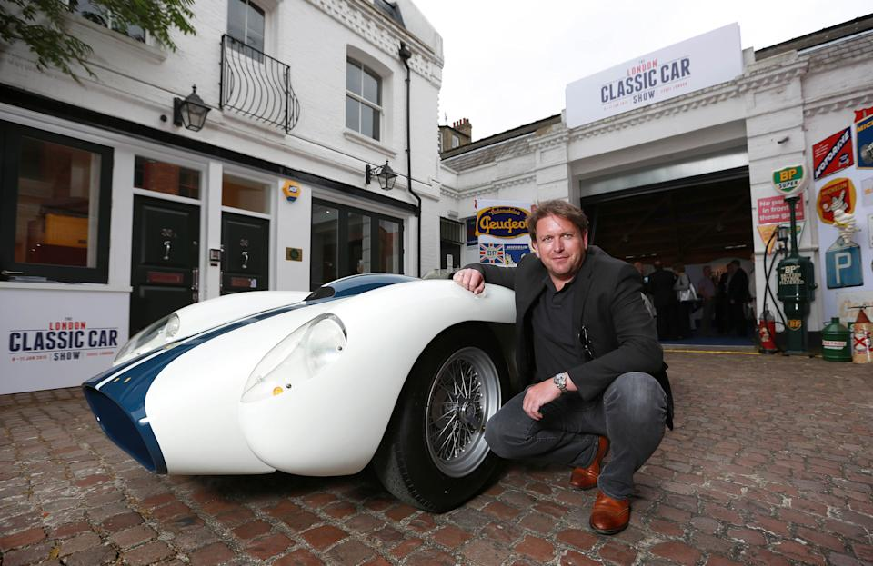 EDITORIAL USE ONLY Television chef James Martin with a 1957 Ferrari TR250 during the launch of the inaugural London Classic Car Show, which will take place at ExCeL between 8th to 11th January 2015, in Kensington, London.