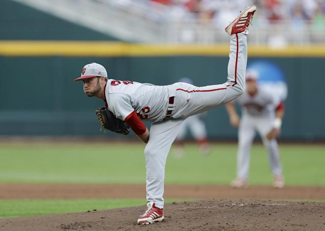 In this photo taken on June 15, 2013, Indiana starting pitcher Joey DeNato delivers against Louisville in the first inning of an NCAA College World Series game in Omaha, Neb. DeNato leads the Big Ten's top pitching staff with an 8-1 record and 2.12 ERA. (AP Photo/Nati Harnik)