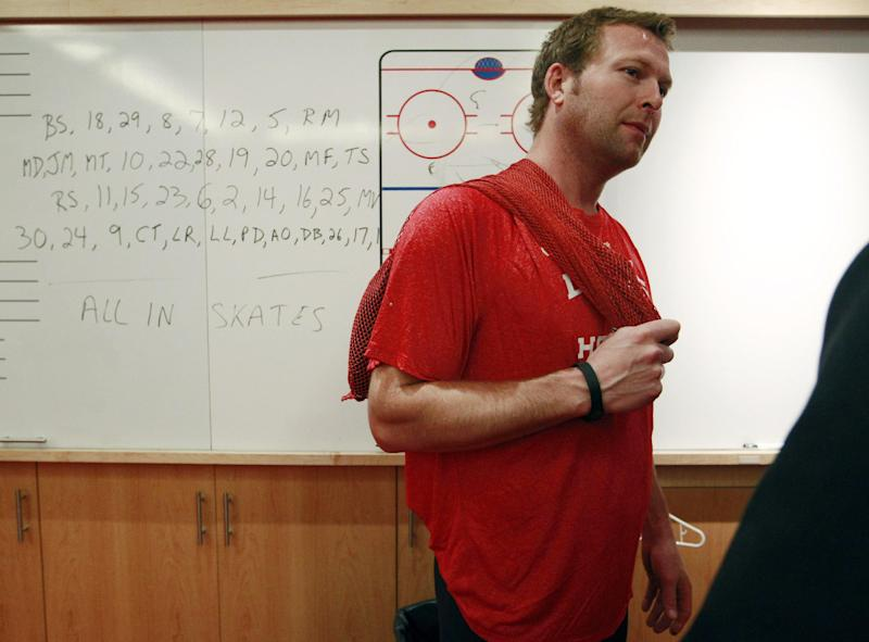 FILE - In this Wednesday, June 13, 2012 file photo, New Jersey Devils goalie Martin Brodeur answers a question as the team packs up for the year in Newark, N.J., after losing the NHL Stanley Cup hockey playoffs to the Los Angeles Kings. On Monday, July 2, 2012, it was announced that Brodeur has signed a new two-year contract to remain with the New Jersey Devils. Pat Brisson, Brodeur's Los Angeles-based agent, confirmed the deal Monday morning in an email to The Associated Press. The deal is worth $9 million and more than likely will allow the 40-year-old goaltender to finish his career with the Devils. (AP Photo/Mel Evans, File)