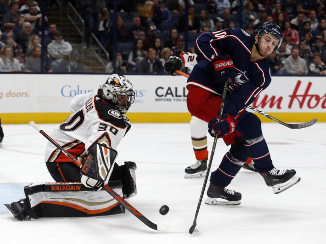 Anaheim Ducks goalie Ryan Miller, left, stops a shot behind Columbus Blue Jackets forward Alexander Wennberg, of Sweden, during the second period of an NHL hockey game in Columbus, Ohio, Friday, Oct. 11, 2019. (AP Photo/Paul Vernon)