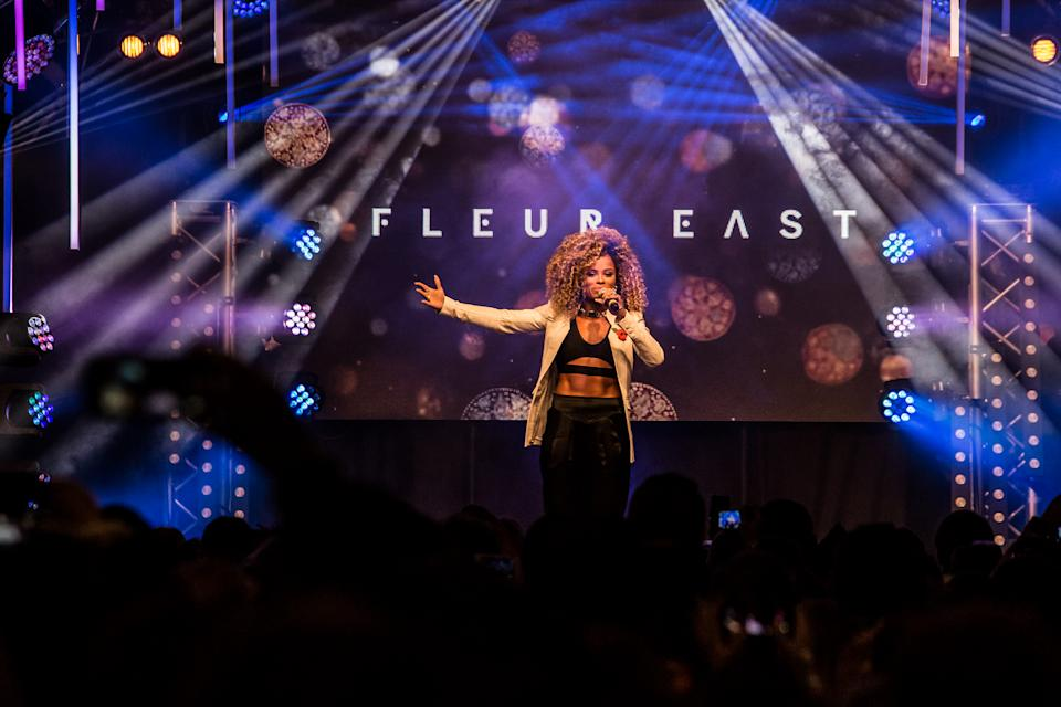 Fleur East performs on stage before the Oxford Street Christmas lights are switched on, in central London, Sunday, Nov. 1, 2015. (Photo by Vianney Le Caer/Invision/AP)