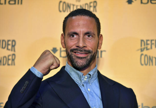 Ex-footballer Rio Ferdinand poses for the media during a press conference at York Hall, London