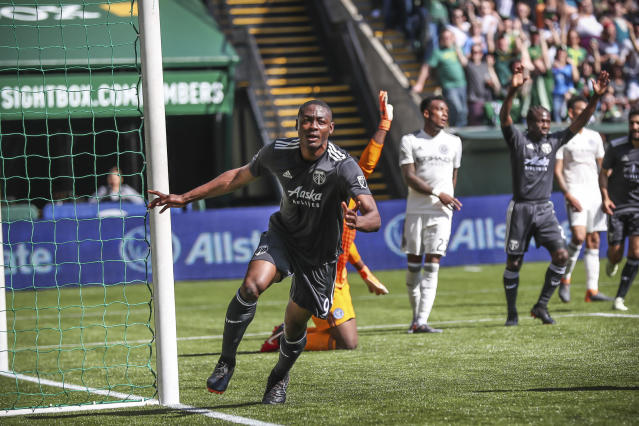 Portland Timbers forward Fanendo Adi celebrates his second goal of the season during an MLS soccer match against New York City FC in Portland, Ore., Sunday, April 22, 2018. (Serena Morones/The Oregonian via AP)