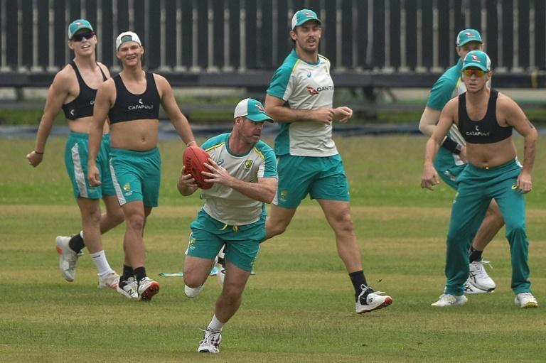 Australia's cricket team plays a game of rugby in a training session ahead of their T20 series against Bangladesh