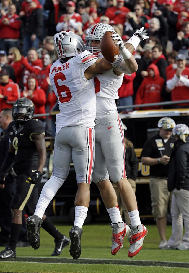 Ohio State tight end Jeff Heuerman, right celebrates with wide receiver Evan Spencer after scoring a touchdown against Purdue during the first half of an NCAA college football game in West Lafayette, Ind., Saturday, Nov. 2, 2013. (AP Photo/Michael Conroy)