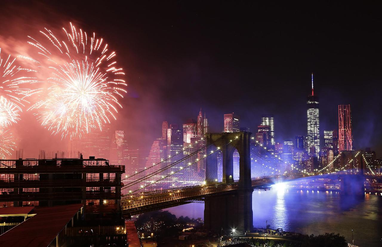 Fireworks light up the sky above the Brooklyn Bridge during Macy's Fourth of July fireworks show, Friday, July 4, 2014, in New York. (AP Photo/Mark Lennihan)