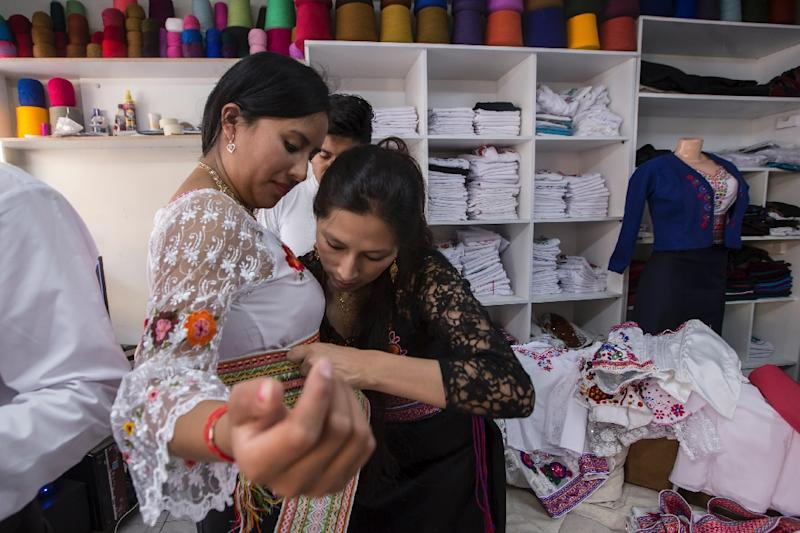 Ecuadoran designers have lured customers back to their roots with traditional garb with a modern edge -- slits, see-through detailing or flaring (AFP Photo/JUAN CEVALLOS)