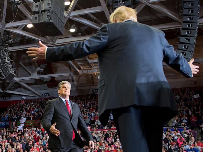 US President Donald Trump greets talk show host Sean Hannity at a Make America Great Again rally in Cape Girardeau, Missouri on November 5, 2018: JIM WATSON/AFP/Getty Images