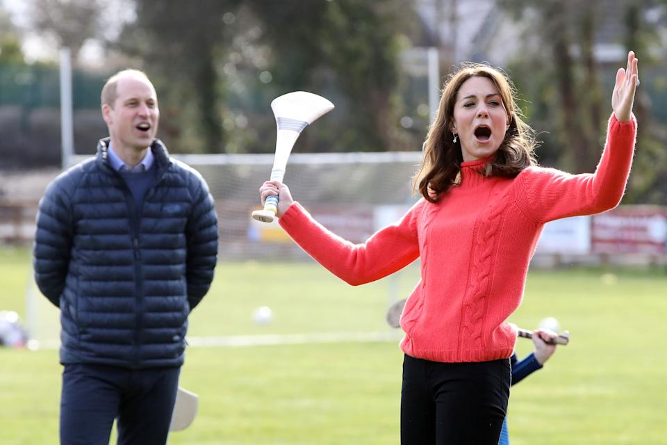 Britain's Prince William, Duke of Cambridge (L) reacts as Britain's Catherine, Duchess of Cambridge attempts to play hurling during a visit to Salthill Gaelic Athletic Association (GAA) club in Galway, western Ireland, on March 5, 2020 on the final day of their three day visit. (Photo by Paul Faith / AFP) (Photo by PAUL FAITH/AFP via Getty Images)