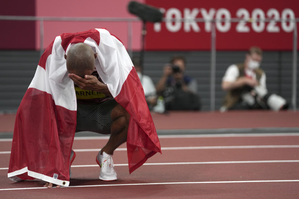 Damian Warner, of Canada reacts after he won the gold medal for the decathlon at the 2020 Summer Olympics, Thursday, Aug. 5, 2021, in Tokyo. (AP Photo/Matthias Schrader)