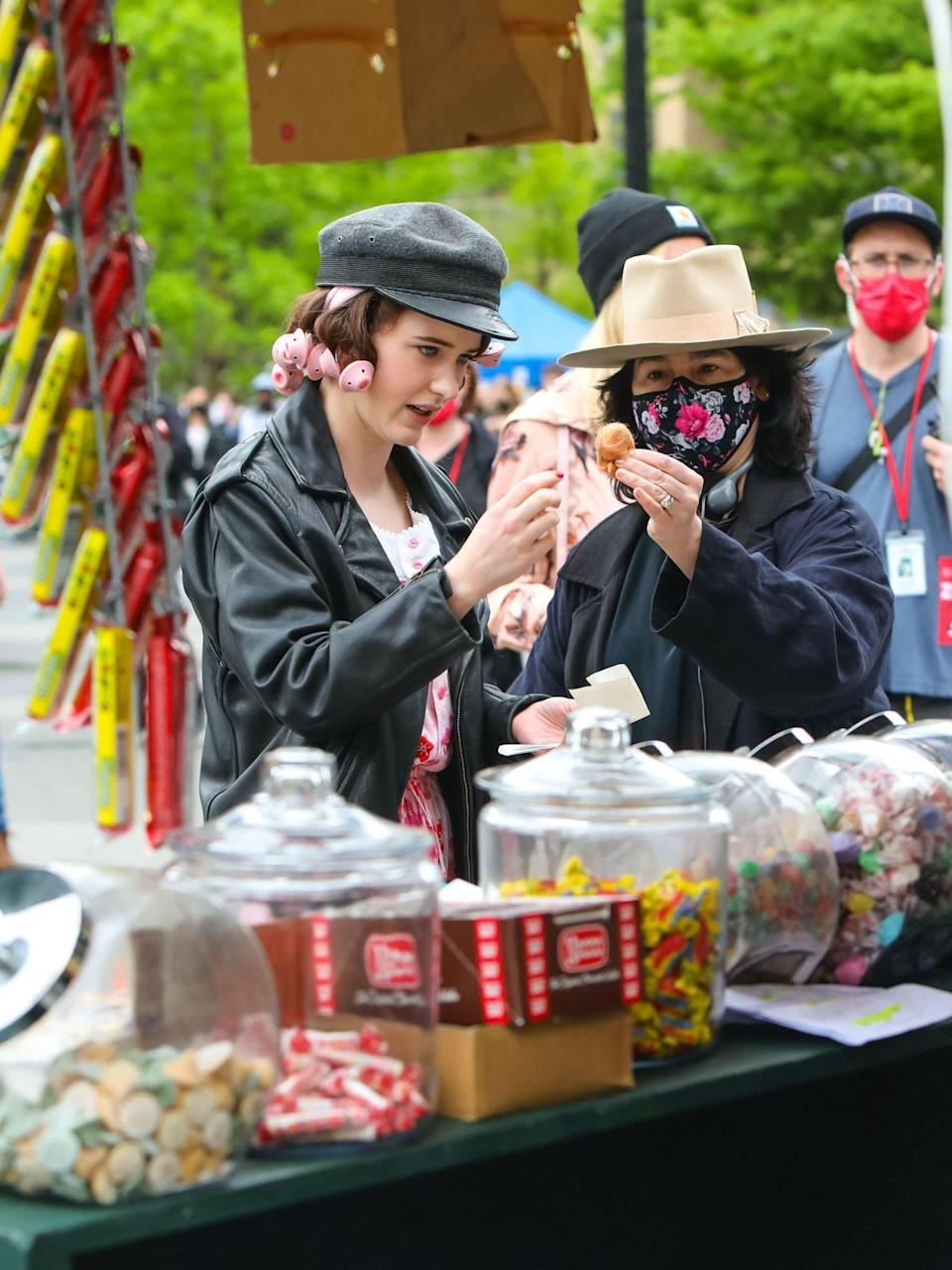 <p>In between takes, Brosnahan chatted with the show's creator, Amy Sherman-Palladino, near a candy cart.</p>