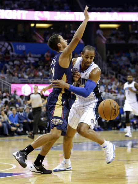 Orlando Magic's Arron Afflalo, right, momentarily loses the ball after running into New Orleans Pelicans' Brian Roberts during the first half of an NBA basketball game in Orlando, Fla., Friday, Nov. 1, 2013. (AP Photo/John Raoux)