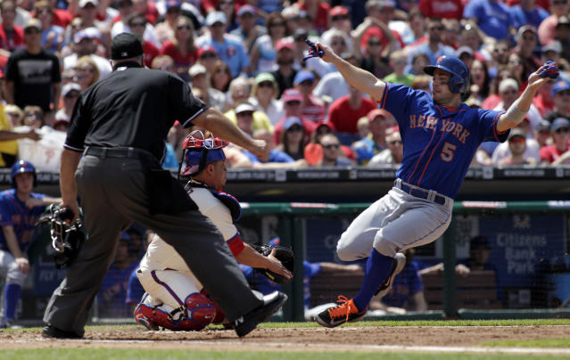 New York Mets' David Wright (5) scores as Philadelphia Phillies' Carlos Ruiz moves for a late tag in the fourth inning of a baseball game, Sunday, June 1, 2014, in Philadelphia. Home plate umpire Brian O'Nora. (AP Photo/H. Rumph Jr)