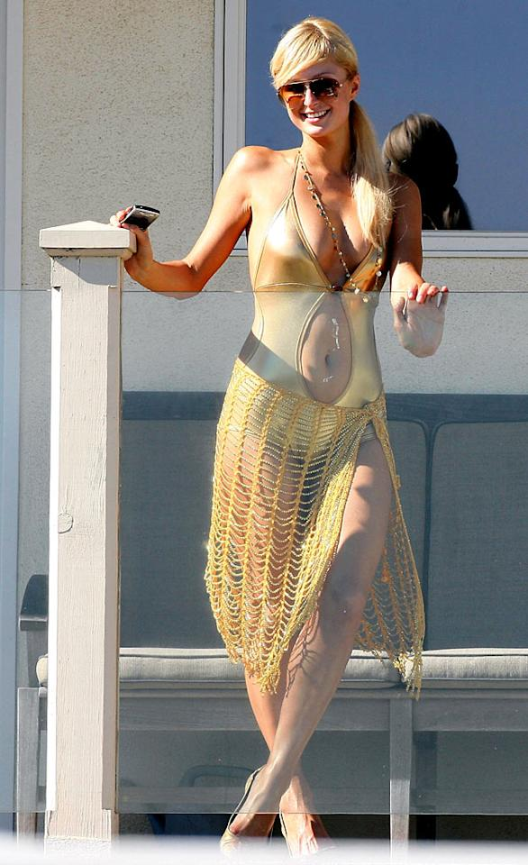 "Nicole's ""Simple Life"" co-star Paris Hilton parades around in an eye-catching gold swimsuit at her Malibu beach house. Cliff and Malia Sobel/<a href=""http://www.splashnewsonline.com"" target=""new"">Splash News</a> - August 18, 2007"