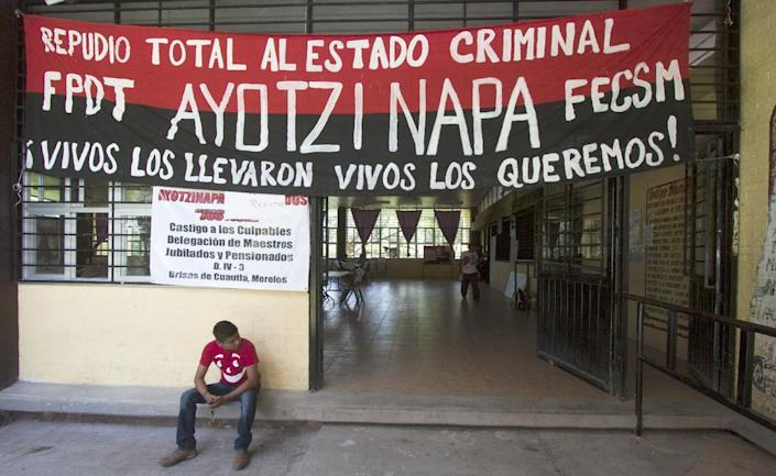A student waits inside the Raul Isidro Burgos de Ayotzinapa school minutes before the departure of a caravan heading for different parts of the country, in Ayotzinapa, Guerrero State on November 13, 2014 (AFP Photo/Hector Guerrero)