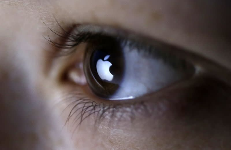 Picture illustration shows Apple Inc's logo reflected in a person's eye, in central Bosnian town of Zenica