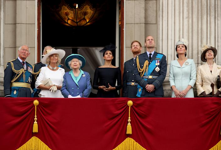Britain's Prince Charles, Camilla, Duchess of Cornwall, Queen Elizabeth, Meghan, Duchess of Sussex, Prince Harry, Prince William, Catherine, Duchess of Cambridge and Princess Anne stand on the balcony of Buckingham Palace as they watch a fly past to mark the centenary of the Royal Air Force in central London, Britain July 10, 2018. REUTERS/Chris Radburn