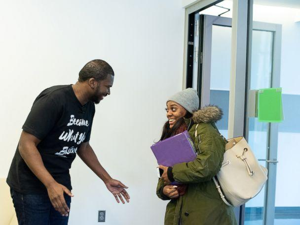 PHOTO: Howard University senior Mya Thompson learns from Rev. Marc Lavarin that Alfred Street Baptist Church is paying her student debt. (Alfred Street Baptist Church)