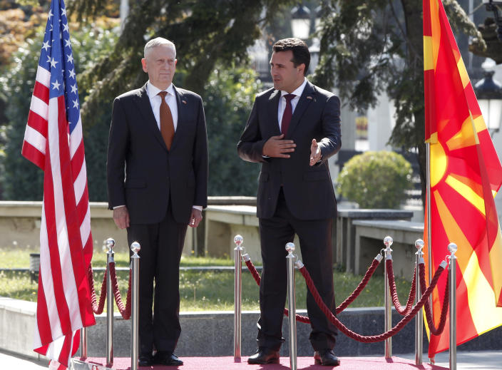 U.S. Defense Secretary James Mattis, left, is welcomed by Macedonian Prime Minister Zoran Zaev, right, upon his arrival at the government building in Skopje, Macedonia, Monday, Sept. 17, 2018.Mattis arrived in Macedonia Monday, condemning Russian efforts to use its money and influence to build opposition to an upcoming vote that could pave the way for the country to join NATO, a move Moscow opposes. (AP Photo/Boris Grdanoski)