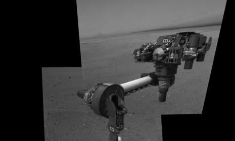A composite image of NASA's Mars rover shows Curiosity extending its robotic arm for the first time, on Aug. 20.