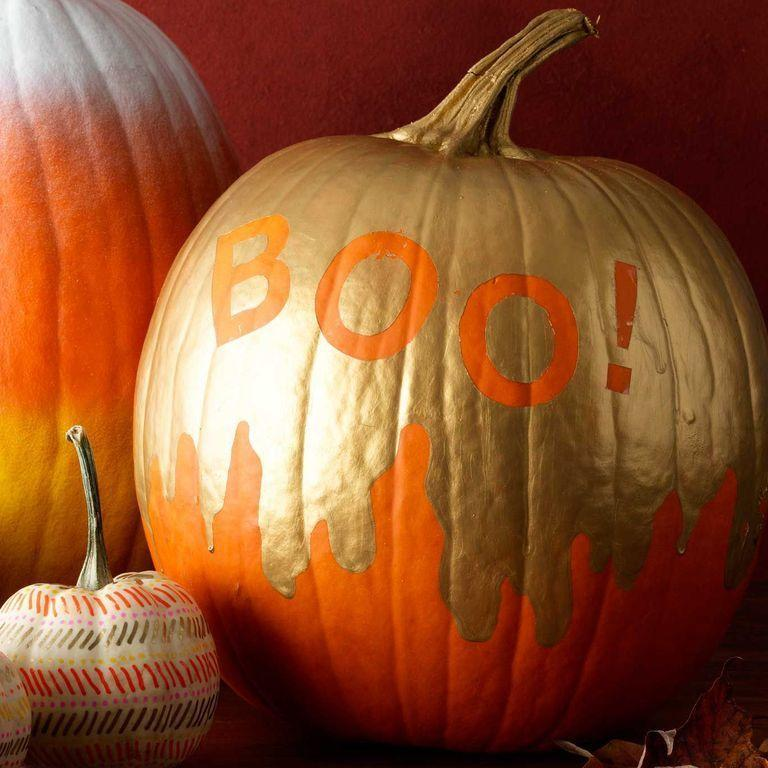 """<p> Prefer your pumpkins to have a bit of glitz and glamor? Use metallic gold paint to create this fun look. Apply stick-on letter stencil to the pumpkin and use a paintbrush to create the drip design. Once dry, peel the stencils off.</p><p><a class=""""link rapid-noclick-resp"""" href=""""https://www.amazon.com/TecUnite-Alphabet-Stencils-Painting-Decoration/dp/B075QZJJ15?tag=syn-yahoo-20&ascsubtag=%5Bartid%7C10070.g.331%5Bsrc%7Cyahoo-us"""" rel=""""nofollow noopener"""" target=""""_blank"""" data-ylk=""""slk:SHOP LETTER STENCILS""""><strong>SHOP LETTER STENCILS</strong> </a></p>"""