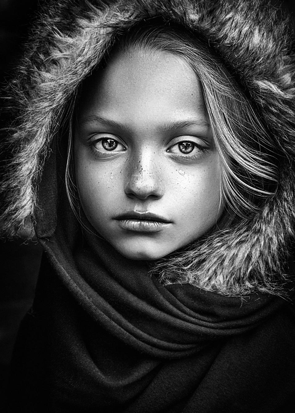 "<p>Portrait of girl in natural light – This highly commended portrait of a young girl came about during a model shoot by Danish photographer Janie Cristina Salskov. The 40-year-old said: ""The portrait is was an improvised art capture during a portfolio winter session outside in natural light."" Source: Janie Cristina Salskov / SWNS </p>"