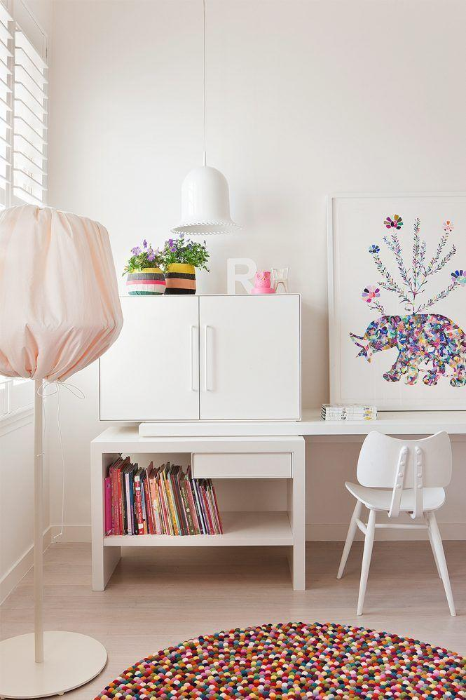 <p>Even if the playroom doubles a homework zone, there's still room fun. Opt for colorful decor, accents, and artwork, and keep all the colorful books out in the open. Even the floor lamp in this work/play kid's space designed by Hecker Guthrie offers a little cheer. </p>