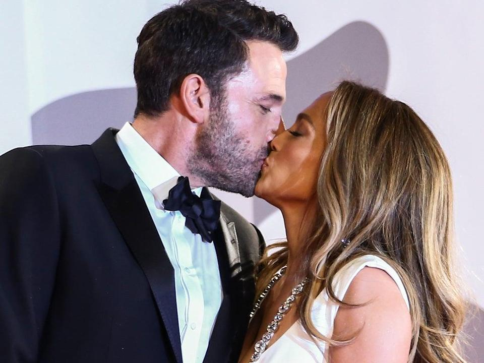 Jennifer Lopez and Ben Affleck kiss upon arriving to the premiere of 'The Last Duel' at the Venice Film Festival on 10 September 2021 (Joel C Ryan/Invision/AP)