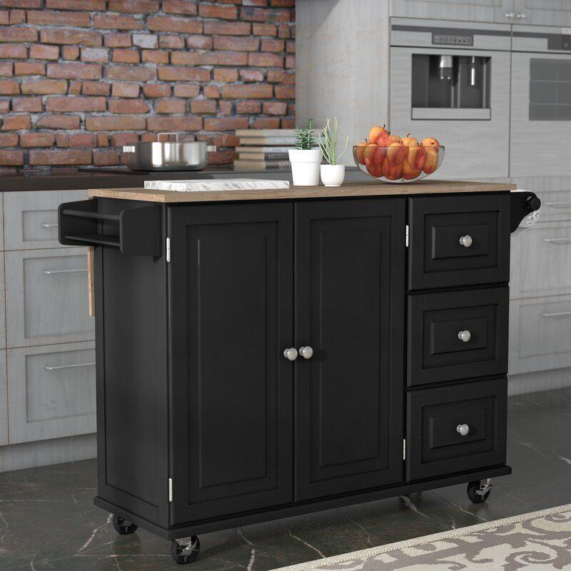 """<p><strong>Andover Mills</strong></p><p>wayfair.com</p><p><strong>$359.99</strong></p><p><a href=""""https://go.redirectingat.com?id=74968X1596630&url=https%3A%2F%2Fwww.wayfair.com%2Ffurniture%2Fpdp%2Fandover-mills-kuhnhenn-kitchen-cart-with-solid-wood-top-w002191607.html&sref=https%3A%2F%2Fwww.popularmechanics.com%2Fhome%2Fg37130942%2Fbest-kitchen-islands%2F"""" rel=""""nofollow noopener"""" target=""""_blank"""" data-ylk=""""slk:Shop Now"""" class=""""link rapid-noclick-resp"""">Shop Now</a></p><p><strong>• Dimensions</strong>: 53.5 x 36 x 17 inches<br><strong>• Countertop</strong>: Wood</p><p>This kitchen cart comes in black or white, and it wins in both form and function. The island features clean lines, raised wood cabinet detailing, a wooden cutting board and oodles of space. There are three drawers, a towel rack and closed-door shelving for utensil, pantry and equipment storage. The island also features a drop-leaf, so you can pull up a stool and have breakfast. Reviewers praised the """"ease of assembly and good price.""""</p>"""