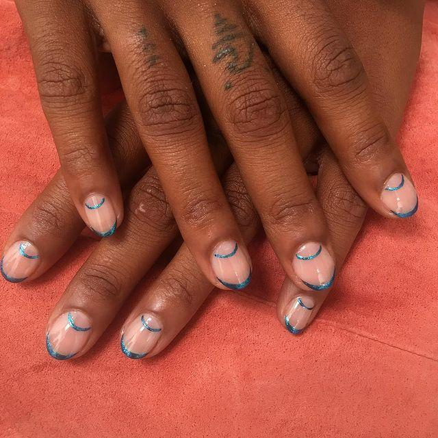 "<p>You can still do a <a href=""https://www.cosmopolitan.com/style-beauty/beauty/g29760575/french-manicure-ideas/"" rel=""nofollow noopener"" target=""_blank"" data-ylk=""slk:French manicure"" class=""link rapid-noclick-resp"">French manicure</a> even if you don't have a ton of free edge to work with. Since round nails perfectly mimic the shape of a half moon, lean into that and make it a half-moon mani, too, while you're at it.</p><p><a href=""https://www.instagram.com/p/BoKSc0FnFPX/?utm_source=ig_embed&utm_campaign=loading"" rel=""nofollow noopener"" target=""_blank"" data-ylk=""slk:See the original post on Instagram"" class=""link rapid-noclick-resp"">See the original post on Instagram</a></p>"
