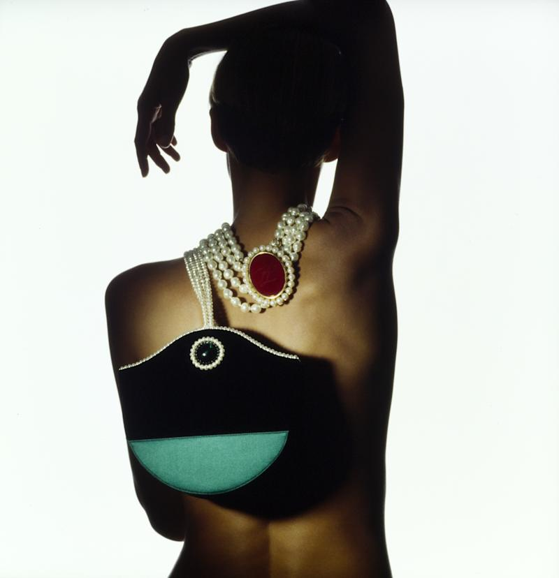Josie Borain, wearing a pearl necklace by Karl Lagerfeld Bijoux, dangles Renaud Pellegrino's pearl-embellished and handled evening bag over her shoulder.