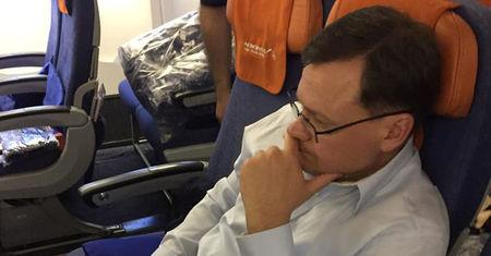 Handout photo of Evgeny Buryakov, a former New York banker who was convicted in federal court of conspiring to act in the United States as an agent of the Russian Federation, is shown in this handout photo sitting on a commercial flight