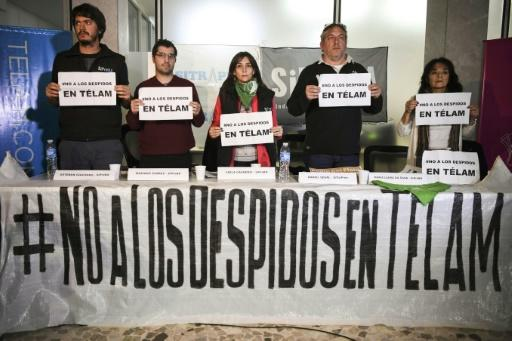 Employees of state news agency Telam, seen here at a press conference in Buenos Aires on July 2, 2018, have been hit by public service layoffs