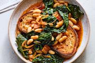 "It's been decided. Beans and greens taste great on any kind of carb: in tortillas, over rice, on flatbread—you name it. Here, we flavor the mix with smoked paprika and thyme, then serve it on skillet-fried country bread. <a href=""https://www.epicurious.com/recipes/food/views/smoky-beans-and-greens-on-toast?mbid=synd_yahoo_rss"" rel=""nofollow noopener"" target=""_blank"" data-ylk=""slk:See recipe."" class=""link rapid-noclick-resp"">See recipe.</a>"