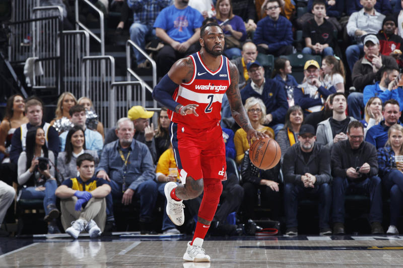 Though he isn't likely to play season after an Achilles injury, John Wall defended the massive contract the Wizards gave him — and reaffirmed his commitment to play there his entire career.