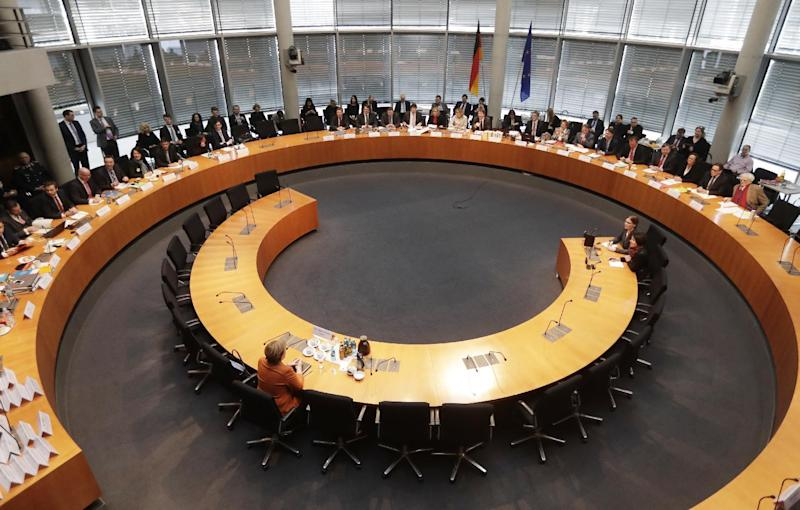 German Chancellor Angela Merkel sits in a questioning at an investigation committee of the German federal parliament looking into alleged U.S. surveillance in Germany and the activities of Germany's own foreign intelligence service in Berlin, Germany, Thursday, Feb. 16, 2017. (AP Photo/Markus Schreiber)