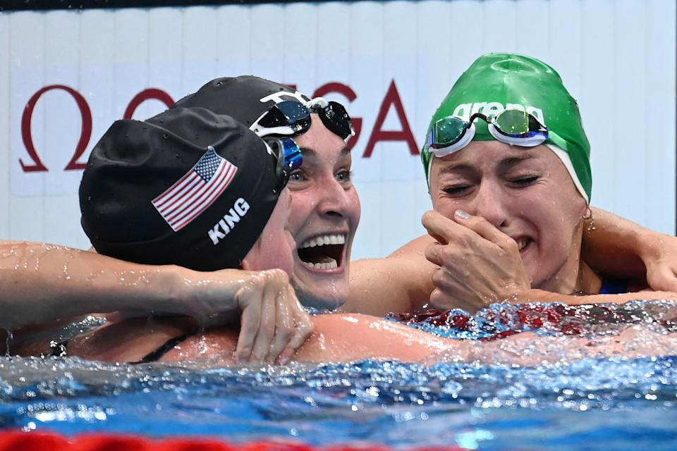 South Africa's Tatjana Schoenmaker (R) reacts with third placed USA's Annie Lazor (C) and second placed USA's Lilly King after winning the final of the women's 200m breaststroke swimming event to set a new World Record during the Tokyo 2020 Olympic Games at the Tokyo Aquatics Centre in Tokyo on July 30, 2021. (Photo by Jonathan NACKSTRAND / AFP) (Photo by JONATHAN NACKSTRAND/AFP via Getty Images)
