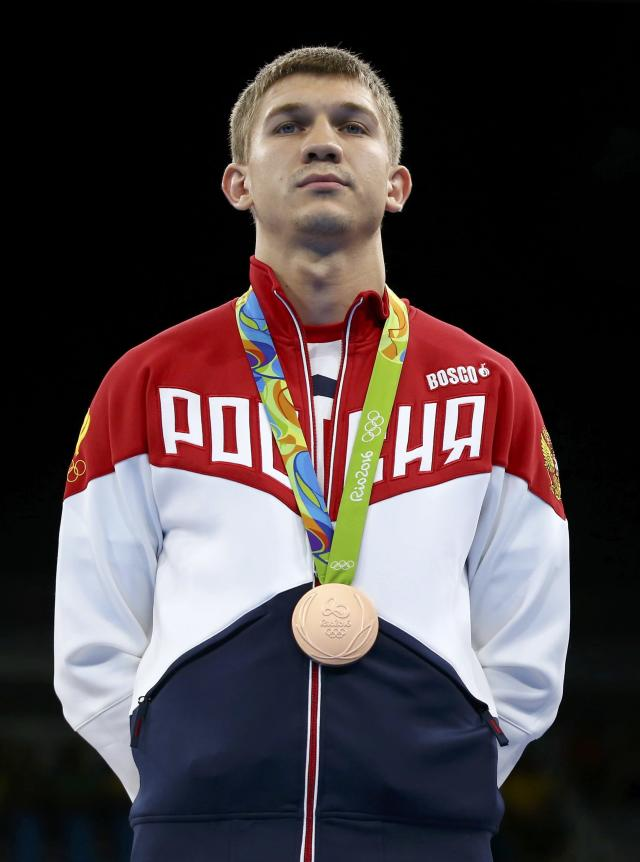 2016 Rio Olympics - Boxing - Victory Ceremony - Men's Light Welter (64kg) Victory Ceremony - Riocentro - Pavilion 6 - Rio de Janeiro, Brazil - 21/08/2016. Bronze medallist Vitaly Dunaytsev (RUS) of Russia poses with his medal. REUTERS/Peter Cziborra FOR EDITORIAL USE ONLY. NOT FOR SALE FOR MARKETING OR ADVERTISING CAMPAIGNS.