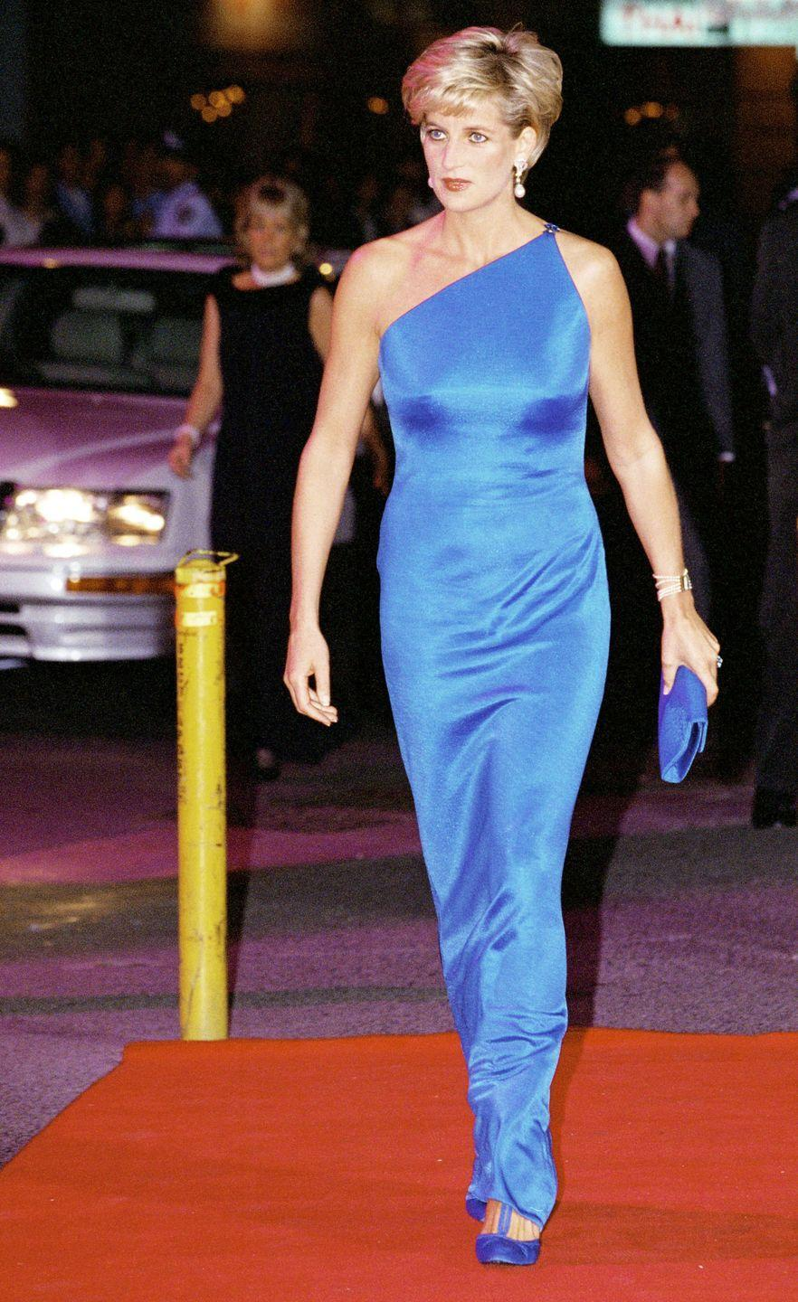 <p>In a blue gown and shoes and holding a matching clutch at an event in New Orleans, Louisiana. </p>