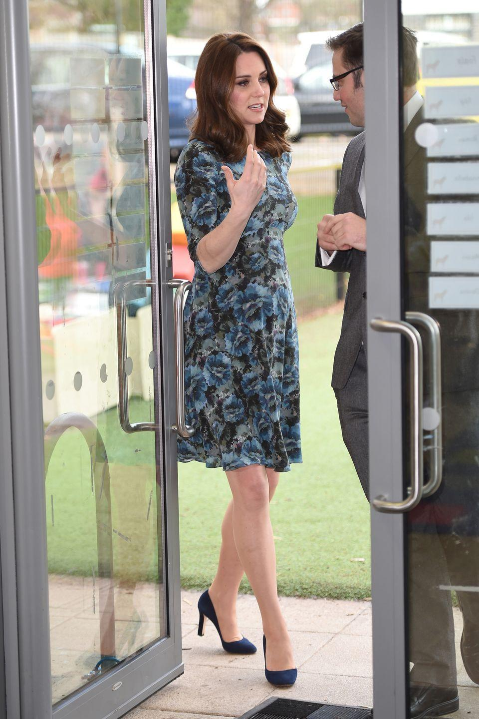 <p>In a three-quarter sleeve blue floral dress and navy blue pumps while visiting the Reach Academy with Place2Be in London.</p>