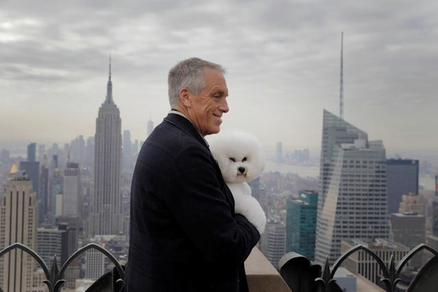 Flynn, a bichon frise and winner of Best In Show at the 142nd Westminster Kennel Club Dog Show, is held by handler Bill McFadden at the Top of the Rock in New York, U.S., February 14, 2018. REUTERS/Lucas Jackson TPX IMAGES OF THE DAY