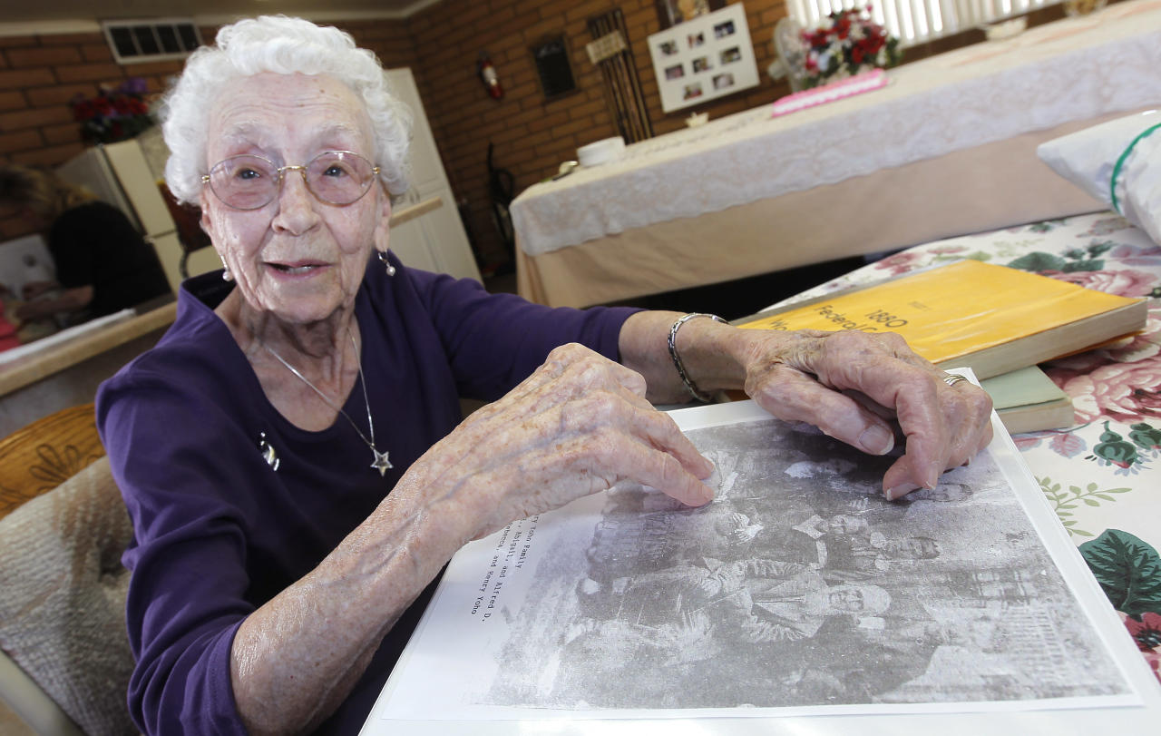 In this March 30, 2012, photo, Verla Morris, who will turn 100 later this year, goes through some of her family census data from the 19th and 20th centuries at her local residential senior center in Chandler, Ariz. When the 1940 census records are released Monday, April 2, Morris will see her own name and details about her life in the records being released after 72 years of confidentiality expires, allowing her to find out more about her family tree. (AP Photo/Ross D. Franklin)