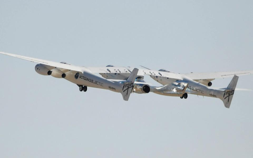 The Virgin Galactic SpaceShipTwo space plane Unity bound for the edge of space with Sir Richard Branson - PATRICK T. FALLON/AFP via Getty Images