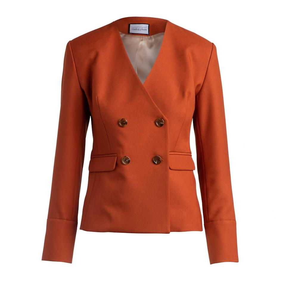 "<p><strong>Undra Celeste </strong></p><p>undracelesteny.com</p><p><strong>$325.00</strong></p><p><a href=""https://www.undracelesteny.com/shop/collarless-blazer-rust"" rel=""nofollow noopener"" target=""_blank"" data-ylk=""slk:Shop Now"" class=""link rapid-noclick-resp"">Shop Now</a></p><p>Suit up, sans lapels, for a minimal take on a double-breasted blazer. </p>"